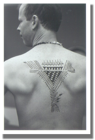 Richard's back showing Toby's henna masterpiece